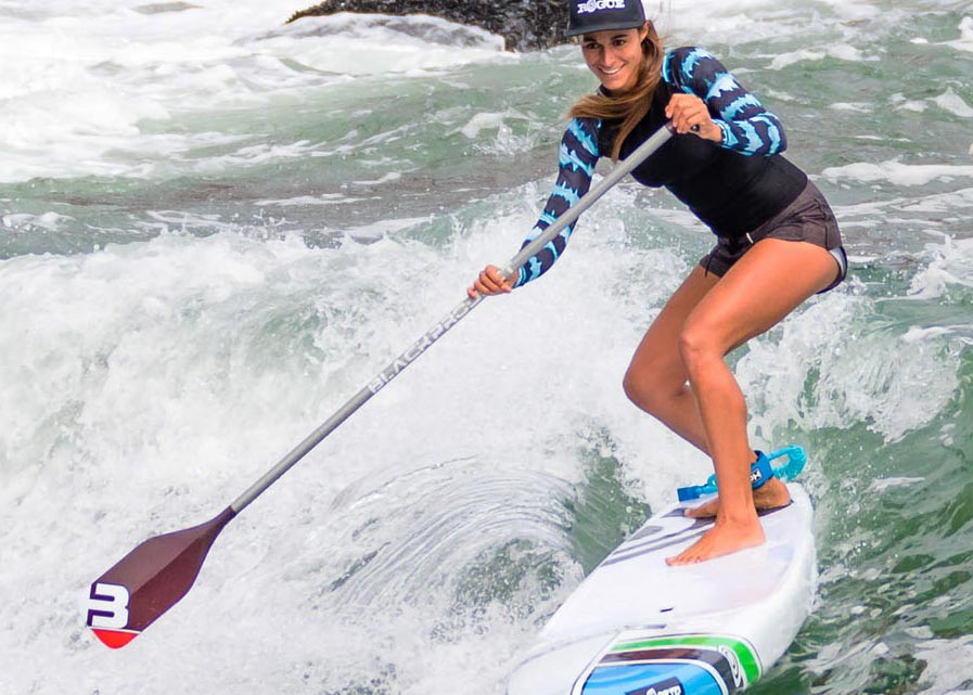 Surfing with Black Project carbon paddle